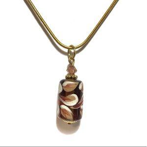 Gold floral pendant necklace